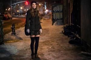 Liza walks to a bar